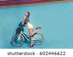 beautiful girl with bicycle on... | Shutterstock . vector #602446622