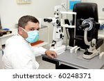 doctor in ophthalmology clinic | Shutterstock . vector #60248371