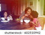 mother and daughters having a...   Shutterstock . vector #602510942