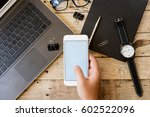 hands of man using phone white... | Shutterstock . vector #602522096