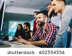 programmers cooperating at  it... | Shutterstock . vector #602554556