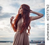 Young Woman With Long Red Hair...