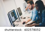 programmers cooperating at  it... | Shutterstock . vector #602578052