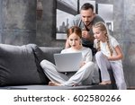 pensive young family using...   Shutterstock . vector #602580266
