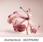 ballerina dancing in flowing... | Shutterstock . vector #602596382