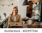 Small photo of Middle aged woman satisfied after her work. Looking at the camera