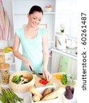 joyful woman cutting pepper at... | Shutterstock . vector #60261487