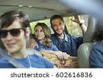 a group of people inside a car  ... | Shutterstock . vector #602616836
