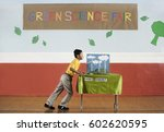 a boy pushing a table into a... | Shutterstock . vector #602620595