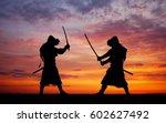 Silhouette Of Two Samurais In...