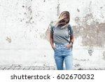 hipster girl wearing blank gray ... | Shutterstock . vector #602670032