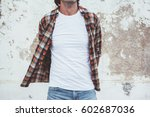 handsome man wearing blank... | Shutterstock . vector #602687036