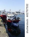 Fishing Boats Docked  Alongsid...