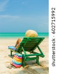 woman sitting on a deck chair... | Shutterstock . vector #602715992