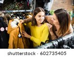 smiling mother and daughter... | Shutterstock . vector #602735405