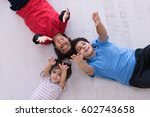happy young boys having fun on... | Shutterstock . vector #602743658