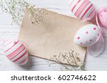 easter eggs and blank note on... | Shutterstock . vector #602746622