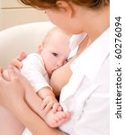 mother breast feeding her infant | Shutterstock . vector #60276094