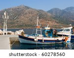 Fishing Boats In The Harbor At...