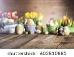 Easter eggs. Colorful bokeh, place for typography and logo. Rustic wooden table. Easter theme. - stock photo