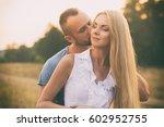 loving couple in a field | Shutterstock . vector #602952755