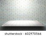 wooden plank shelves and white... | Shutterstock . vector #602970566