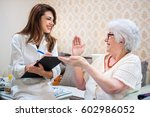 senior woman is visited by her... | Shutterstock . vector #602986052