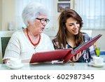 grandma and her granddaughter... | Shutterstock . vector #602987345