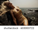 pretty girl in diamond dress  | Shutterstock . vector #603003722