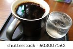 black coffee with ice | Shutterstock . vector #603007562