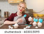 young smiling woman cooking... | Shutterstock . vector #603015095
