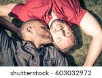 Happy Gay Couple Lying Down On...