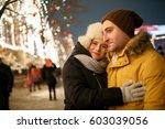 night photo of happy couple | Shutterstock . vector #603039056