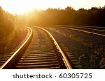 Curved Railroad In Sunset