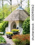 Small photo of Small cosy alcove surrounded by blooming flowers in Keukenhof park in Netherlands, Europe