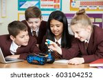 school pupils in science lesson ... | Shutterstock . vector #603104252