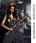 sexy female miner worker with... | Shutterstock . vector #603110312