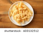 plate with tasty cheese fries... | Shutterstock . vector #603132512