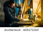 man doing some carpentry work... | Shutterstock . vector #603172265
