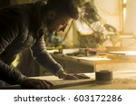 man doing some carpentry work... | Shutterstock . vector #603172286