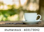 coffee cup with coffee beans on ... | Shutterstock . vector #603173042