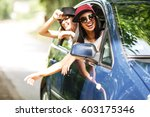 two young women on car trip... | Shutterstock . vector #603175346