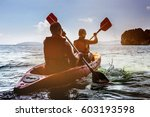 Man And Woman Swims On Kayak I...
