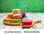 colorful macarons on vintage... | Shutterstock . vector #603234836