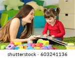 mother and toddler playing... | Shutterstock . vector #603241136