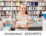 smiling child girl holding a... | Shutterstock . vector #603248552