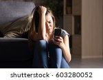 front view of a sad teen... | Shutterstock . vector #603280052