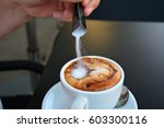 man's hand pouring  sugar into... | Shutterstock . vector #603300116