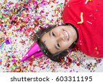 young boy blows out confetti ... | Shutterstock . vector #603311195