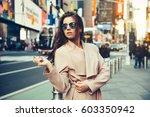 fashionable girl walking on new ... | Shutterstock . vector #603350942